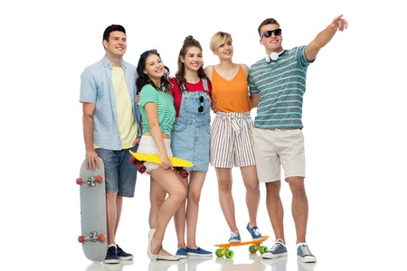 friends with skateboards over white background Stock Photo