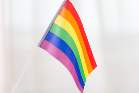 pride, and concept - close up of rainbow flag