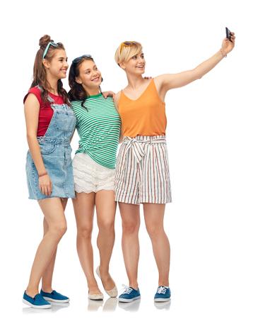 happy female friends taking selfie by smartphone Stock Photo