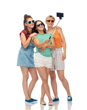 happy female friends taking selfie by smartphone Stock Photo