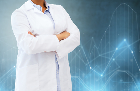 science and medicine concept - female doctor or scientist over blue background and diagrams charts holograms