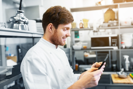 cooking, profession and people concept - happy male chef cook with tablet pc computer at restaurant kitchen Stock fotó