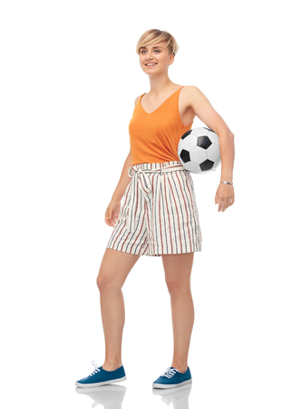 sport, leisure and people concept - smiling teenage girl with soccer ball over white background