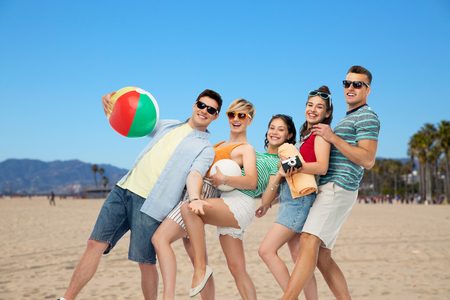 happy friends over venice beach Stock Photo