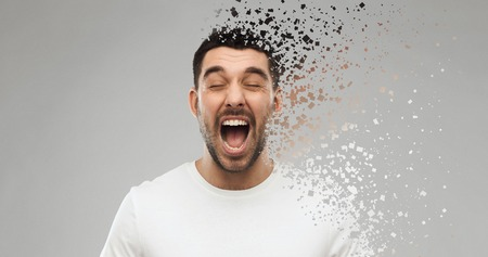 crazy shouting man in t-shirt over gray background