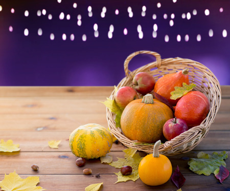 close up of pumpkins in basket on wooden table Stock Photo