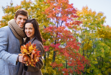 smiling couple hugging in autumn park Stock Photo