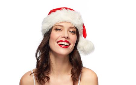 Mujer con lápiz labial rojo con gorro de Papá Noel en Navidad Foto de archivo