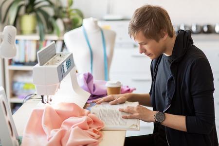 fashion designer reading book at studio