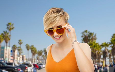 portrait of smiling young woman in sunglasses