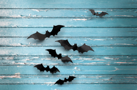 black bats over blue shabby boards background Stock Photo