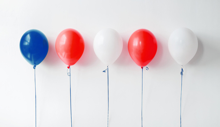 party decoration with red, white and blue balloons Imagens