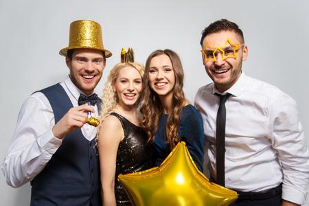happy friends with golden party props posing Stock fotó