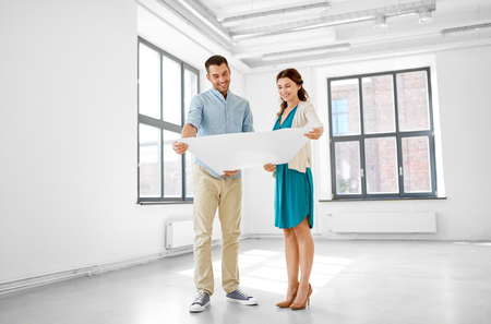happy couple with blueprint at new home Stock Photo