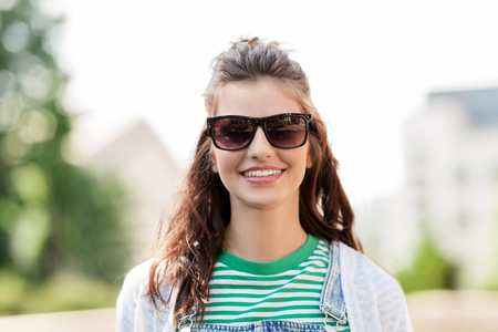 portrait of young woman in sunglasses outdoors