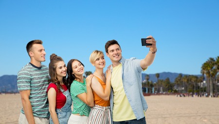 friends taking selfie over venice beach