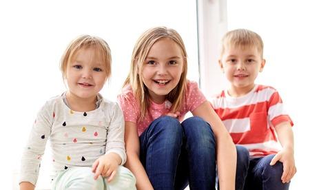 happy little kids having fun at window 版權商用圖片