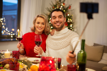 couple taking picture by selfie stick at christmas Stock Photo