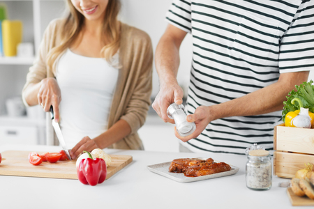 couple cooking food together at home