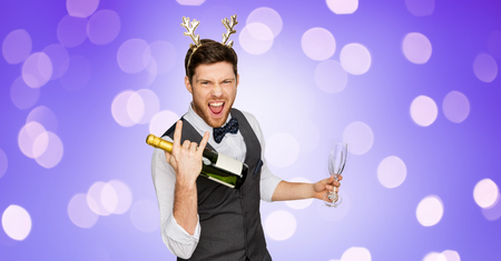 man with bottle of champagne at christmas party