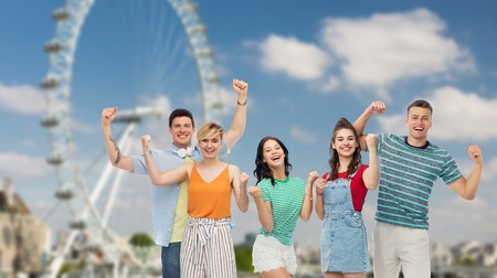 happy friends making fist pump over ferry wheel Stok Fotoğraf