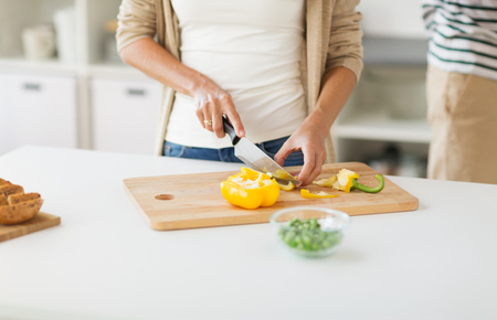 close up of woman chopping vegetables at home Stock Photo