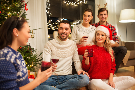 friends celebrating christmas and drinking wine
