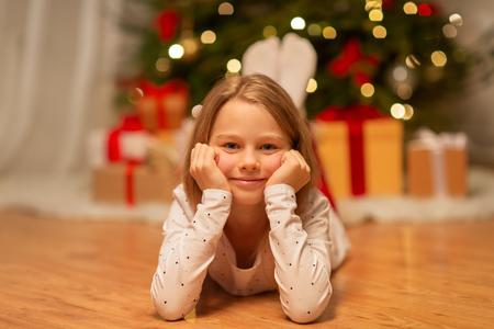 smiling girl at christmas home Banco de Imagens