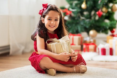 happy girl with christmas gift at home