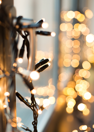 close up of christmas garland on window Stock Photo