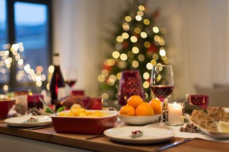 food and drinks on christmas table at home