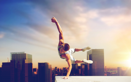 man making parkour jumping over tokyo city