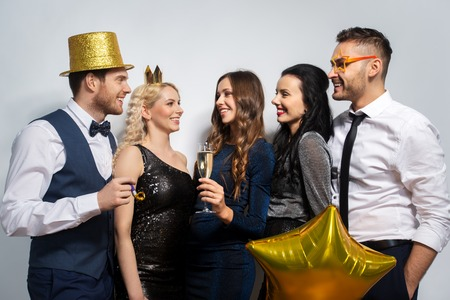 happy friends with golden party props posing Stock Photo