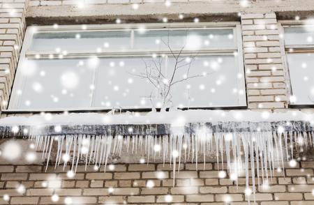 icicles on building or living house facade