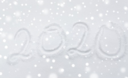 winter holidays and new year concept - calendar number 2020 or date on snow surface