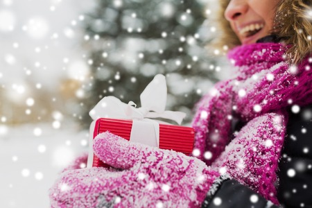 close up of woman with christmas gift outdoors Reklamní fotografie