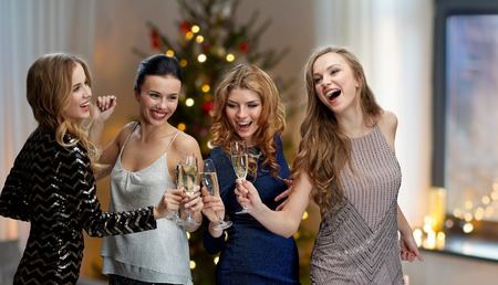 Happy women clinking champagne glasses