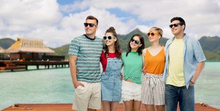 Friends in sunglasses over bora bora background