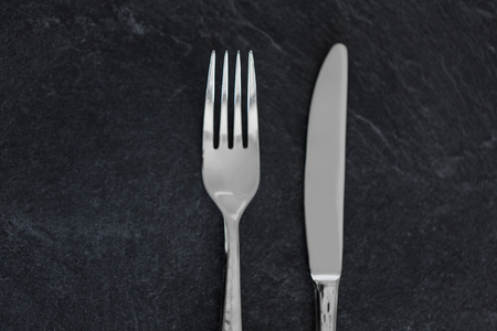 close up of fork and knife on table