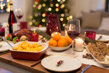 glass of red wine and food on christmas table Stock Photo