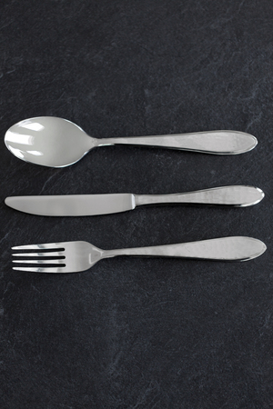 close up of fork, knife and spoon on table