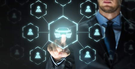 businessman with virtual hologram of car sharing Stock Photo