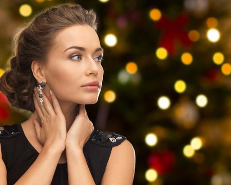beautiful woman with diamond jewelry on christmas