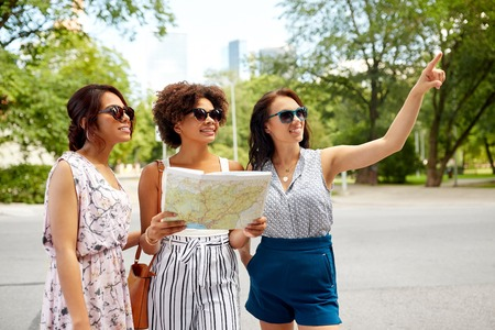happy women with map on street in summer city Standard-Bild - 109920355