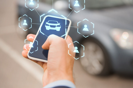 businessman hand with smartphone car sharing app