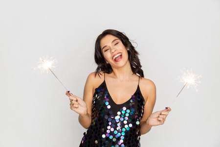 happy young woman with sparklers at party Stock Photo