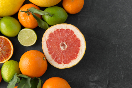 close up of citrus fruits on stone table