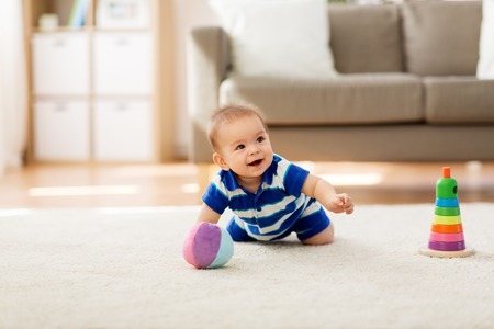 sweet little asian baby boy with toys at home