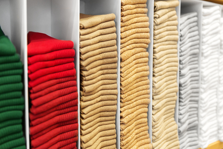 close up of shelves with clothes at clothing store Zdjęcie Seryjne