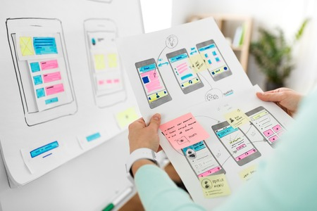 close up of ui designer with templates at office Imagens